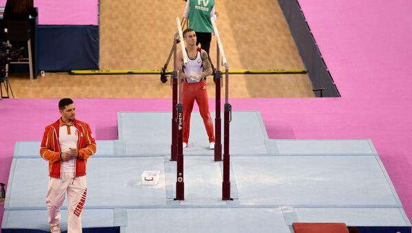 Выступление Олега Степко на Кубке мира по спортивной гимнастике серии FIG Challenge - Sputnik Азербайджан