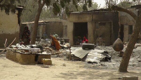 Жертвы нападения террористической группировки Боко Харам в Нигерии - Sputnik Азербайджан