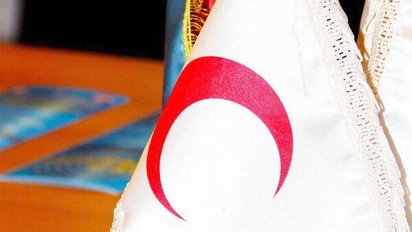 Флаг Национального общества Красного полумесяца. Архивное фото - Sputnik Азербайджан