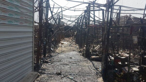 В четверг на рынке, расположенном в поселке 8 километр, ранее известном как автомобильный произошел сильный пожар - Sputnik Азербайджан