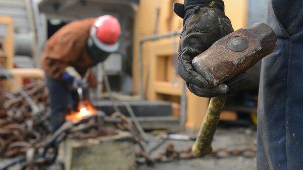 Рабочие на стройке, фото из архива - Sputnik Азербайджан