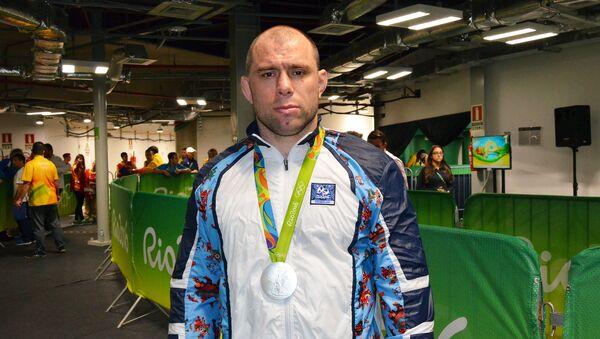 Серебряный призер Летних Олимпийских игр 2016 Хетаг Газюмов - Sputnik Азербайджан