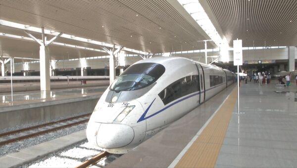 Первый рейс самого быстрого пассажирского поезда в мире - Sputnik Азербайджан