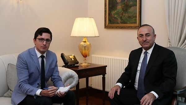 Мевлут Чавушоглу дает интервью журналисту Sputnik Турция - Sputnik Азербайджан