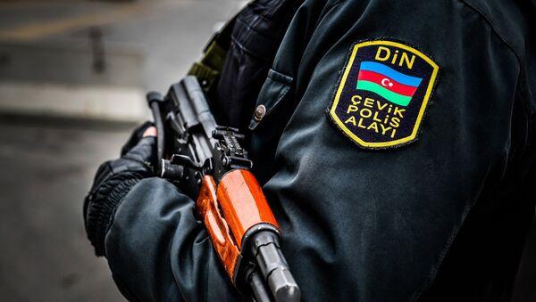 Сотрудник Полицейского полка быстрого реагирования при МВД Азербайджана, фото из архива - Sputnik Азербайджан