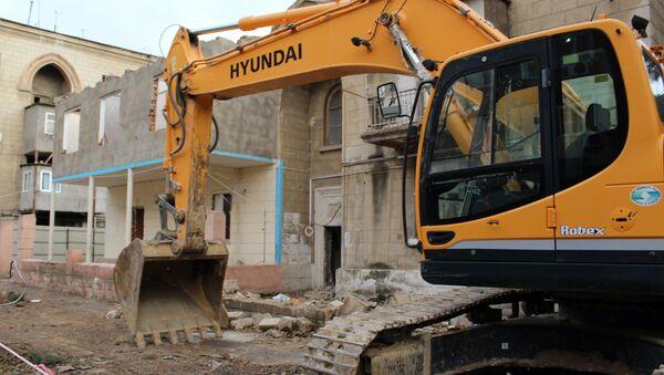 Cнос дома на улице Фаига Юсифова в Наримановском районе Баку - Sputnik Азербайджан