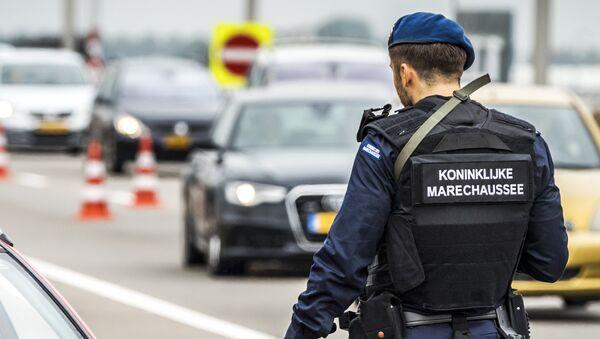 Полицейский в Амстердаме, фото из архива - Sputnik Азербайджан