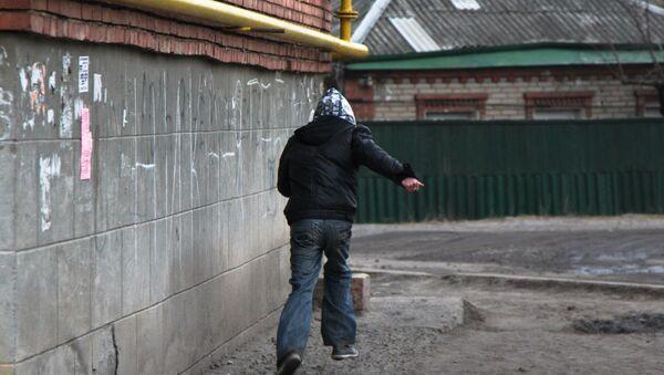 Грабитель, фото из архива - Sputnik Азербайджан