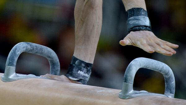 Cпортивная гимнастика среди мужчин, фото из архива - Sputnik Азербайджан