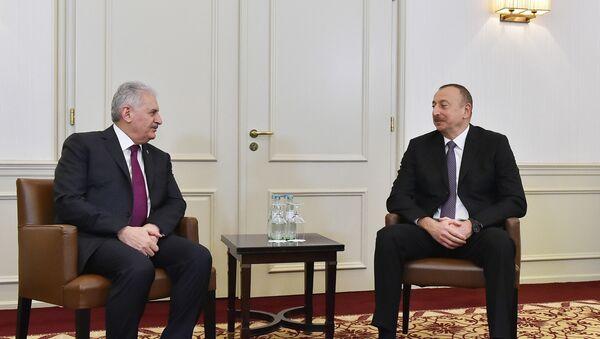 Встреча президента Азербайджана Ильхама Алиева с премьер-министром Турецкой Республики Бинали Йылдырымом - Sputnik Азербайджан