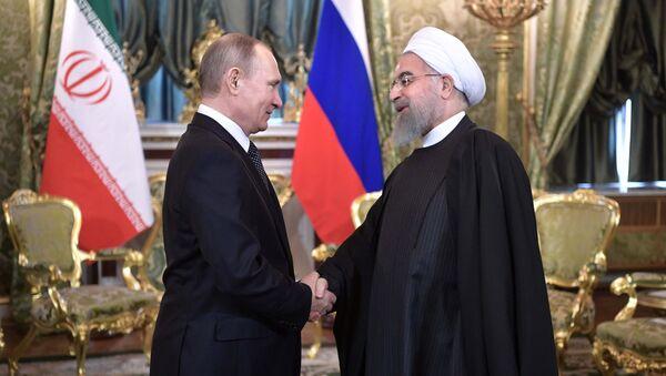 Президент РФ Владимир Путин и президент Исламской Республики Иран Хасан Рухани во время встречи, 28 марта 2017, архивное фото - Sputnik Азербайджан