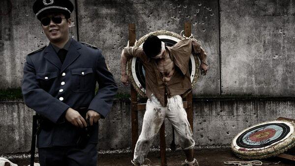 Инсценировка казни, фото из архива - Sputnik Азербайджан