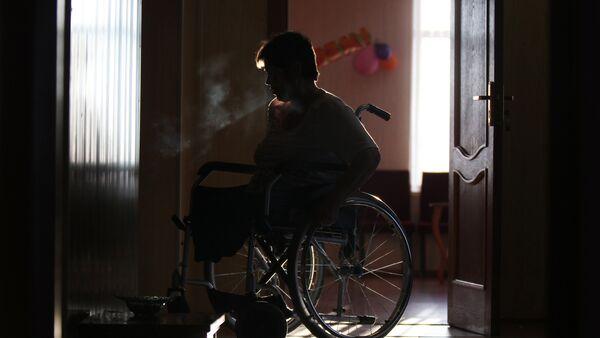 Женщина в инвалидной коляске, фото из архива - Sputnik Азербайджан