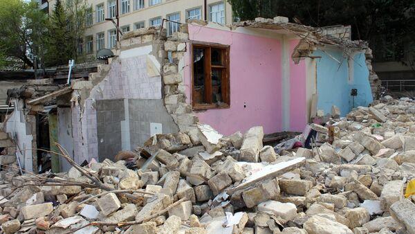 Остатки снесенного дома 193 по улице Сулеймана Рустама, фото из архива - Sputnik Азербайджан