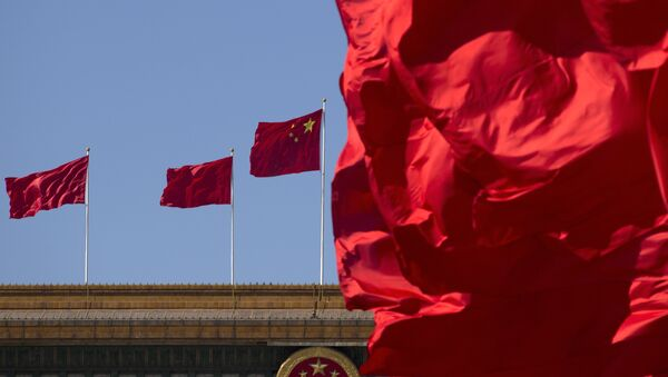 Флаги Китая на здании Дома народных собраний в Пекине, фото из архива - Sputnik Азербайджан