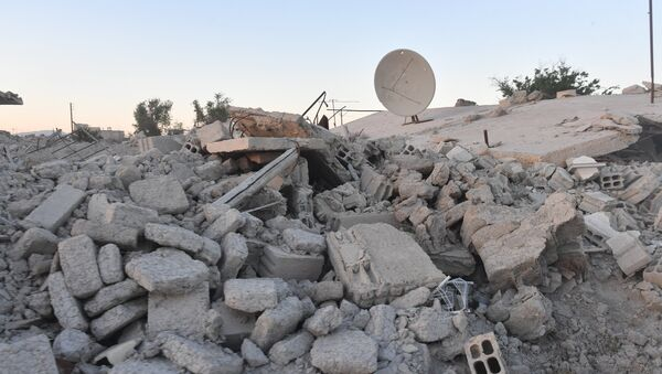 Здания, разрушенные в результате боевых действий в пригороде Дамаска Восточная Гута - Sputnik Азербайджан
