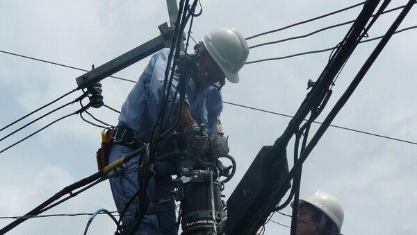 Электрик, фото из архива - Sputnik Азербайджан