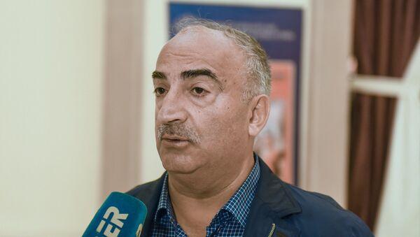 Заслуженный деятель искусств Азербайджана Натиг Расулзаде - Sputnik Азербайджан