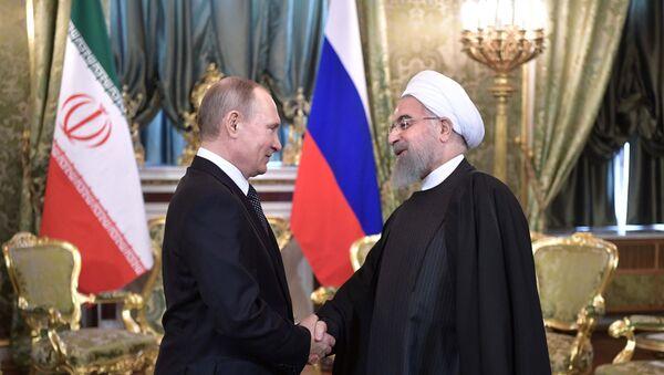 Президент РФ Владимир Путин и президент Исламской Республики Иран Хасан Рухани во время встречи, 28 марта 2017 года - Sputnik Азербайджан
