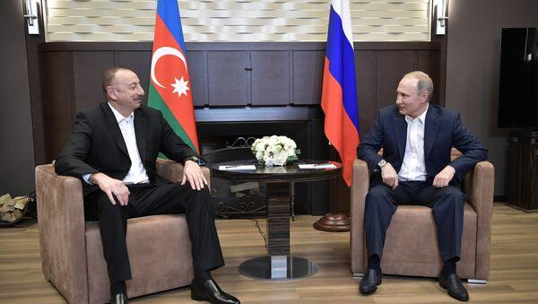 Президент РФ Владимир Путин и президент Азербайджана Ильхам Алиев во время встречи, 21 июля 2017 года - Sputnik Azərbaycan