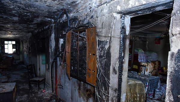 Последствия пожара в здании общежития в восьмом микрорайоне Сумгайыта - Sputnik Azərbaycan