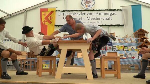 Чемпионат по армрестлингу  с использованием лишь пальцев в Баварии - Sputnik Азербайджан