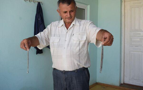 Хозяин дома Шахин Мухтаров за три года убил 62 змеи - Sputnik Азербайджан