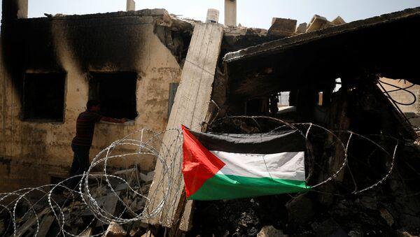 Cнесенный израильскими войсками дом в деревне Дейр Мешал, недалеко от Западного берега Рамаллаха, фото из архива - Sputnik Азербайджан