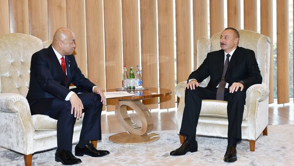 Ильхам Алиев с парламентским заместителем министра иностранных дел Японии Манабу Хори - Sputnik Азербайджан