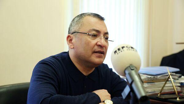 председатель Государственного комитета по делам беженцев и вынужденных переселенцев Ровшан Рзаев - Sputnik Азербайджан