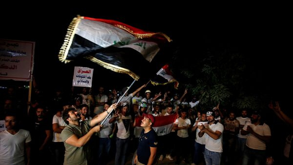 Иракцы празднуют захват Киркука иракскими войсками - Sputnik Азербайджан