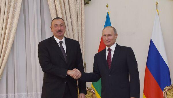 Президент Азербайджана Ильхам Алиев и президент Российской Федерации Владимир Путин во время встречи в Тегеране, 1 ноября 2017 года - Sputnik Азербайджан