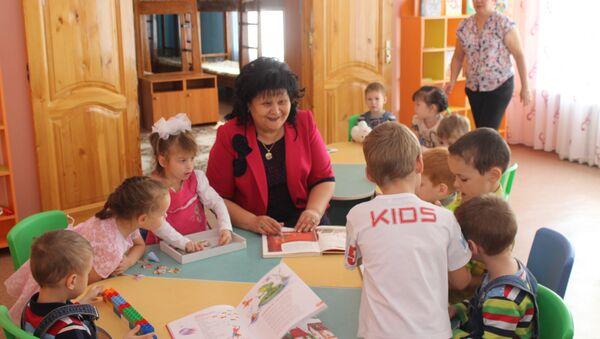Директор детского дома Умит Майра Бейсеканова - Sputnik Азербайджан
