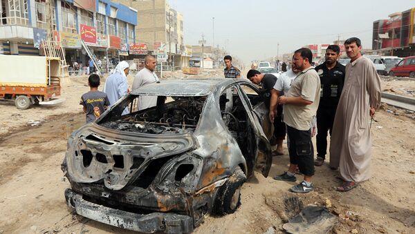 Ситуация на месте теракта в Багдаде, фото из архива - Sputnik Азербайджан