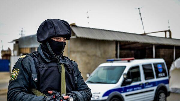 Полицейский в Нардаране, фото из архива - Sputnik Азербайджан