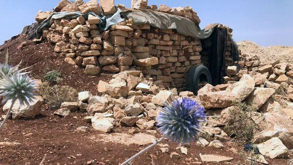 Место базирования террористов Джебхат-ан-Нусра в горном районе Эрсаль на ливано-сирийской границе в долине Увейни - Sputnik Азербайджан