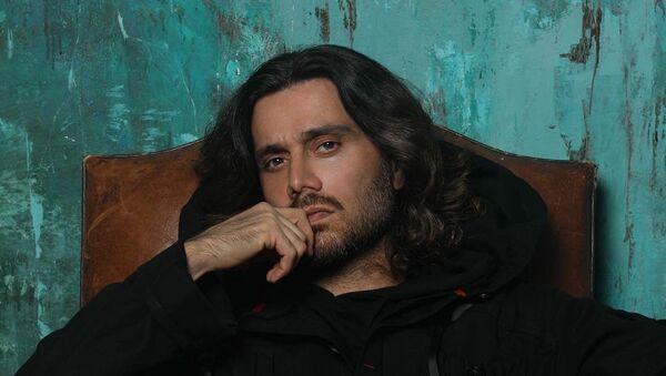 Стилист и певец Аслан Ахмадов, фото из архива - Sputnik Азербайджан