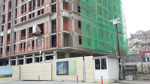 Строящийся жилой дом в Баиловском поселке Баку - Sputnik Азербайджан