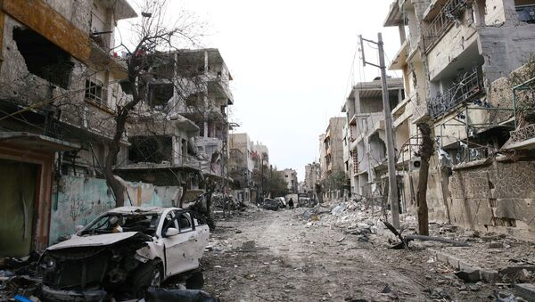 Разрушения в Восточной Гуте, Сирия, 25 февраля 2018 года - Sputnik Азербайджан