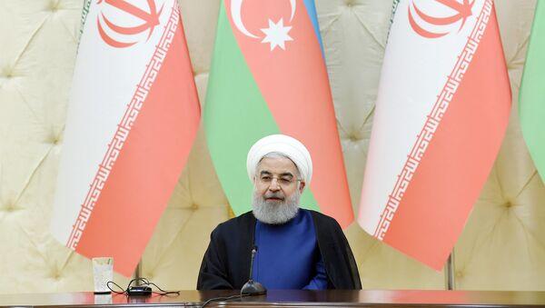 Президент Хасан Роухани в ходе выступления глав Азербайджана и Ирана с заявлениями для печати - Sputnik Азербайджан