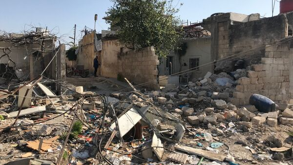 Поселение Джендерес в кантоне Африн на севере Сирии после авиационного и артиллерийского обстрела со стороны Вооруженных сил Турции - Sputnik Азербайджан