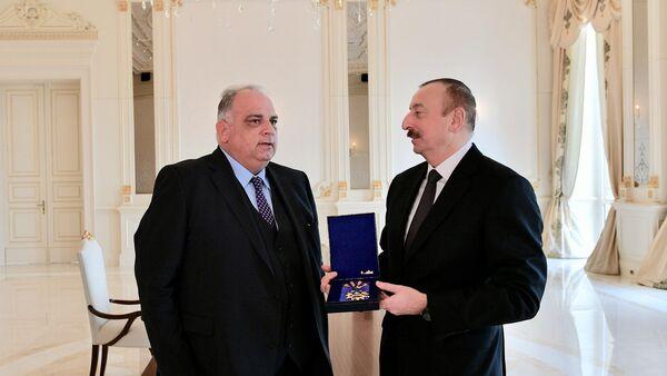 Президент Ильхам Алиев принял президента Всемирного объединения борьбы - Sputnik Азербайджан