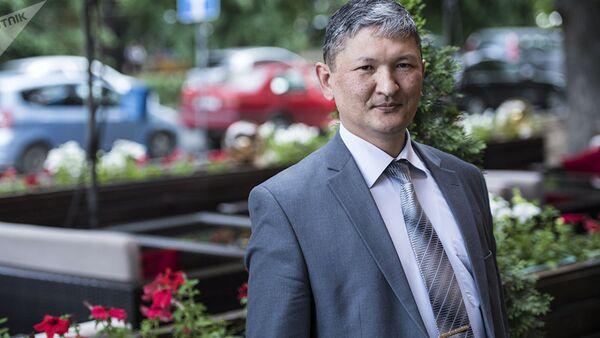 Директор Республиканского центра СПИД Улан Кадырбеков - Sputnik Азербайджан
