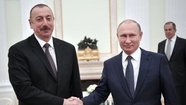 Президент РФ Владимир Путин и президент Азербайджана Ильхам Алиев во время встречи - Sputnik Азербайджан