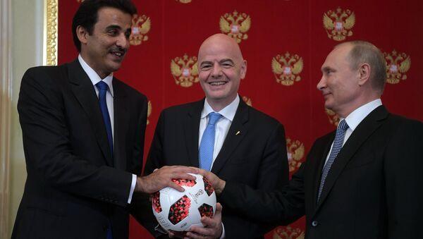 Президент РФ В. Путин принял участие в церемонии передачи Катару полномочий на проведение ЧМ-2022 по футболу - Sputnik Азербайджан