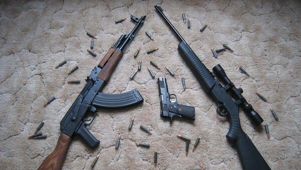 Огнестрельное оружие и патроны, фото из архива - Sputnik Азербайджан