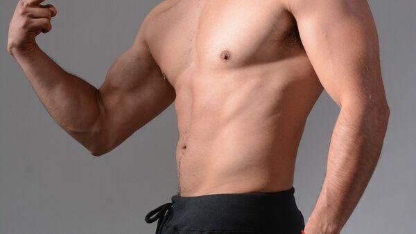 Мужчина спортивного телосложения, фото из архива - Sputnik Азербайджан