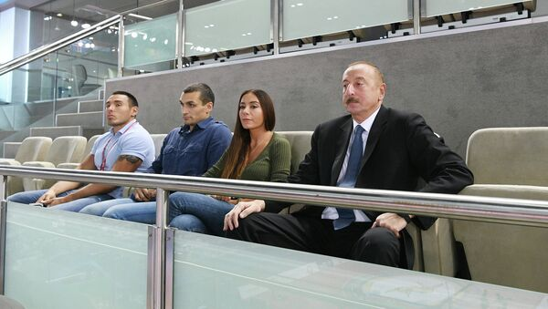 Президент Азербайджанской Республики Ильхам Алиев и члены семьи наблюдают за соревнованиями по дзюдо, 22 сентября 2018 года, фото из архива - Sputnik Азербайджан