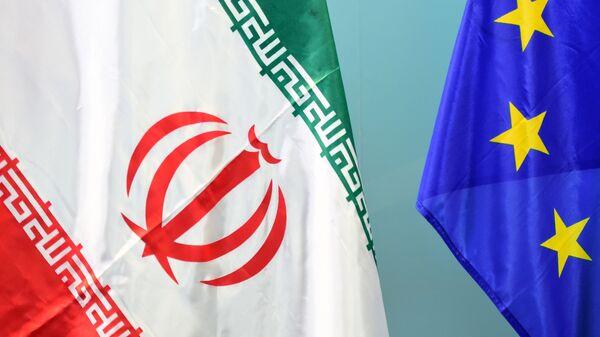 Флаги Ирана и ЕС, фото из архива - Sputnik Azərbaycan