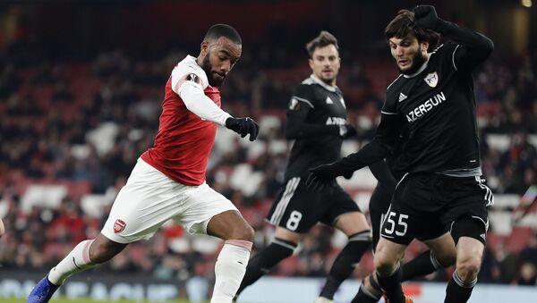 Мачт между английским Арсеналом и азербайджанским Карабахом, 13 декабря 2018 года - Sputnik Азербайджан